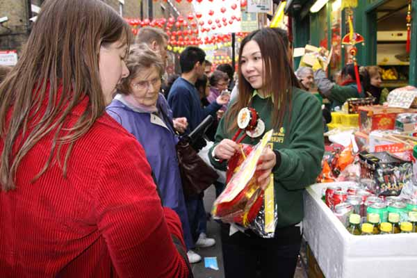 Shoppers look at stall, Chinese New Year in London